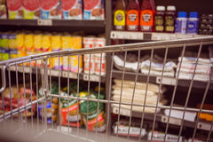 Trolley with product on shelf Royalty Free Stock Photo