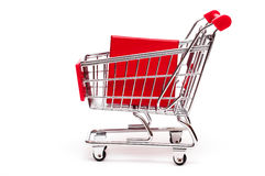 Trolley with a red present Stock Photos
