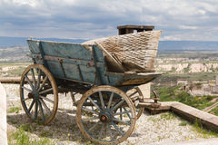 The trolley on the roof. Trolley stands on the roof of the house on the slopes of the ancient fortress of Uchisar. Cappadocia Stock Images