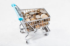 Trolley with russian coins on concrete board Royalty Free Stock Photo