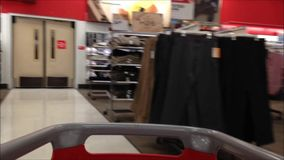 Trolley in store. Fast motion of people pushing trolley inside Target store stock video footage