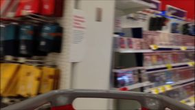 Trolley in store. Fast motion of people pushing trolley inside Target store stock video