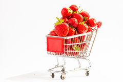 Trolley with strawberries. A lot of strawberries at miniature shopping cart Royalty Free Stock Photography
