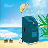 Trolley suitcase with a sun hat Royalty Free Stock Photo