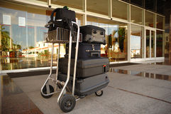 Trolley with suitcases at hotel royalty free stock images