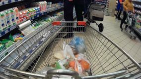 Trolley in a supermarket with goods time lapse go pro stock footage