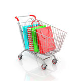 Trolley for supermarket which are multicolored paper bags for sh Royalty Free Stock Images