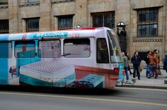 Trolley tram and commuters on Sarajevo street Bosnia Hercegovina Royalty Free Stock Image