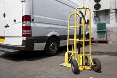 Trolley and van outside warehouse Royalty Free Stock Photography