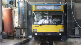 Trolley washing. Sofia, Bulgaria - September 18, 2015: The driver of the trolley car is washing the vehicle in the tram depot stock video footage
