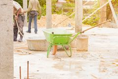 Trolley and workers in workplace construction. With copy space add text royalty free stock photos