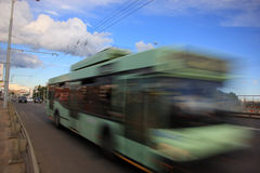 Trolleybus in the city in the daytime. The movement of a diluted trolleybus in the city in the daytime royalty free stock photography