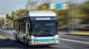 Trolleybus. A trolley bus on a blurred background in motion Royalty Free Stock Photos