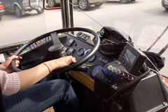 Trolleybus and women`s hands on the steering wheel Royalty Free Stock Image
