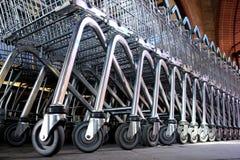 Trolleys. Row of metal trolleys in a supermarket Royalty Free Stock Photo