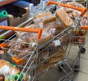 Trolleys with fresh bread in the supermarket `Dixie` royalty free stock photos