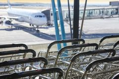 Trolleys at international airport. Runaway and finger. Travel ba Royalty Free Stock Photos