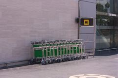 Trolleys for luggage in airport Stock Images