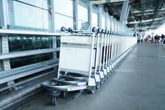 Trolleys luggage in a raw in airport Stock Image