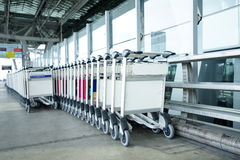 Trolleys luggage in a raw in airport Royalty Free Stock Photo