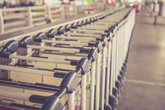 Trolleys luggage in a row in airport Royalty Free Stock Images