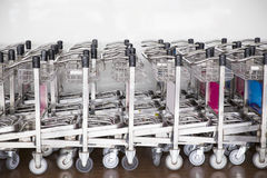 Trolleys luggage in a row in airport Stock Photos