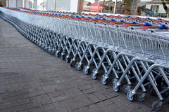 Trolleys. Row of shopping trolleys in a front of a supermarket Royalty Free Stock Photography