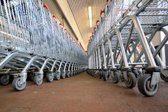 Trolleys. Row of shopping trolleys at supermarket Royalty Free Stock Image