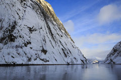 Trollfjord with snow-capped mountains Royalty Free Stock Photo