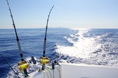 Trolling offshore fisherboat rod reels wake sea. Reflection horizon Stock Photos