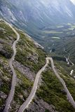 Trollstigen. Curvy road with large gap in Norway royalty free stock image