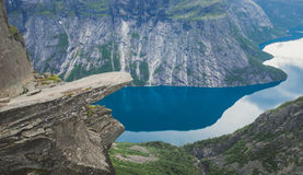 Trolltunga - famous rock formation and tourist famous hike, beautiful norwegian summer landscape with fjord, mountain and lake. Trolltunga - famous rock royalty free stock photography