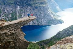 Couple of tourists on Trolltunga in Norway Royalty Free Stock Image