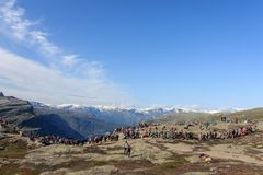Trolltunga, Norway - August 26, 2017: Many people waiting in a long line to get out on the Trolltunga for their. Photograph, as they want to have their moment royalty free stock images