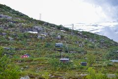 Trolltunga, Odda, Norway: 21. June 2016, Mountain cabins and houses on the hiking trail to the world famous Trolltunga rock, royalty free stock image
