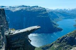 Trolltunga summer view (Norway) and man on rocks edge. Stock Image