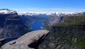 Trolltunga-Troll's tongue rock. Image of Trolltunga - Troll's tongue rock formation above lake Ringedalsvatnet in Norway Stock Image