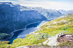 Trolltunga. Troll tongue is a piece of rock jutting horizontally out of a mountain about 700 metres 2,300 ft above the north side of the lake Ringedalsvatnet in Stock Images