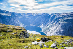 Trolltunga. Troll tongue is a piece of rock jutting horizontally out of a mountain about 700 metres 2,300 ft above the north side of the lake Ringedalsvatnet in Royalty Free Stock Photos