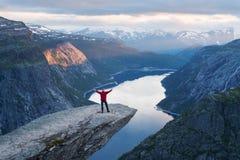 Tourist on Trolltunga in Norway Stock Photos