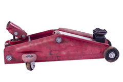 Trolly Jack. A dirty well used red trolley jack Royalty Free Stock Image