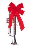 Trombeta do Natal com a curva isolada Foto de Stock