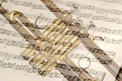 Trombeta e notas Imagens de Stock