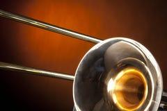 Trombone aislado en el oro Imagen de archivo libre de regalías