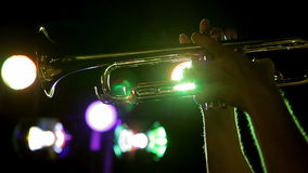 Trombone on the background lights. A man plays the trombone in the background lights stock video footage