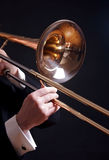 Trombone on black Stock Images