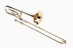 Trombone. Brass slide trombone on a white background Royalty Free Stock Image