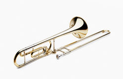 Trombone. Brass slide trombone on a white background Royalty Free Stock Photo