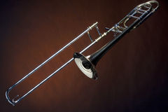 Trombone Isolated Against Gold Spotlight Royalty Free Stock Photography