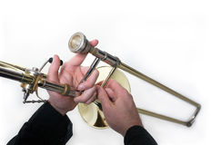 Trombone musician. Close-up - Golden trombone and a musician Stock Images